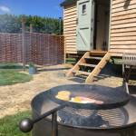 photo of fire pit cooking breakfast